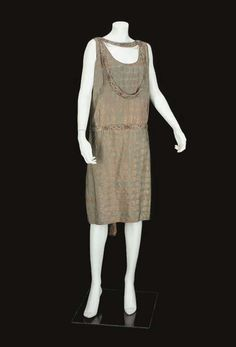 1920s COCKTAIL DRESS, POSSIBLY PAUL POIRET  the green-grey ground woven with bronze and gold in a spot motif, slightly ruched beneath the waist, with a narrow colourfully beaded waistband and similar strap around the neck, unlabelled