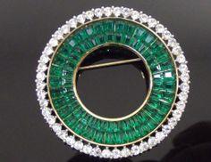 Trifari invisibly set emerald rhinestone circle brooch