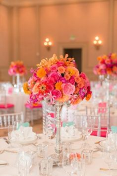 lovely centerpiece in pink, fuchsia, coral.  View More: http://katelynjames.pass.us/tony-and-gabby-wedding