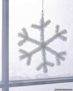 This snowflake's sparkly clusters are made by dipping shaped pipe cleaners into borax dissolved in boiling water with food coloring. As the water cools, borax forms crystals that cling to pipe cleaners.