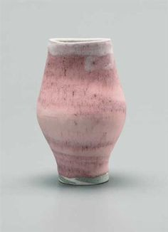 Vase with oval lip, Mixed clay body combining with glaze resulting in a pink and white integral spiral. Mineral elements mixed into the body material producing a lightly pitted, speckled surface.18.2 cm. (7 1/4 in.) high, c.1980
