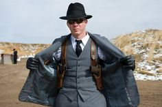 3 piece suit, fedora dual 1911/ w/ shoulder holster. AKA me during the zombie apocalypse lol