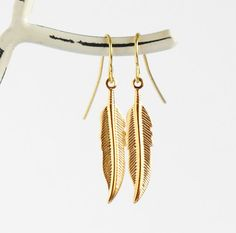 Golden Feather Earrings  Gold Plated by JacarandaDesigns on Etsy, $15.00