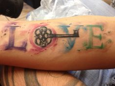 Key to love water colored tattoo