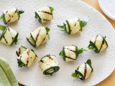 Cooking Channel serves up this Grilled Zucchini Rolls with Herbs and Cheese recipe from Ellie Krieger plus many other recipes at CookingChannelTV.com