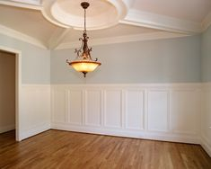 Sherwin-Williams Tradewind (walls), Dover White (trim), Biscuit 50% (ceiling)