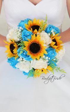 This is a round bouquet made with sunflowers and turquoise roses accented with babies breath Fall Wedding Bouquets, Bride Bouquets, Turquoise Wedding Bouquets, Wedding Centerpieces, Star Wedding, Rose Wedding, Maroon Wedding, Ivory Wedding, Sunflower Wedding Decorations