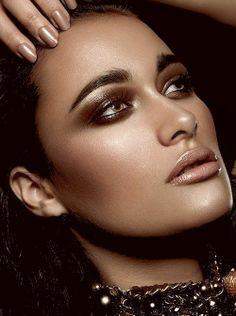 Stunning brown make up and blush.