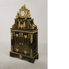 Filing-cabinet and clock Attributed to André-Charles Boulle (1642 - 1732)	, (clock and filing-cabinet)	 Jean Moisy (1714 - 1782), Movement Maker France and England c. 1715 (clock and filing-cabinet) c.1766 (clock movement) 1834 - 1845 (cupboard base and filing cabinet transformed into medal cabinet)