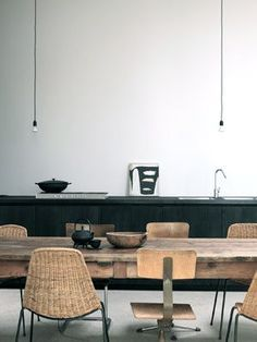 gray, white and vintage french style wood dining table. modern rustic kitchen. simple and modern kitchen lights.