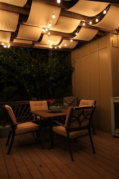 this would work really well and I'd love it. but alas, it rains too much here. the lights and trellis could work though.