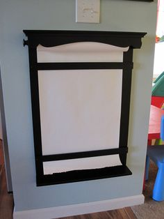 "Saw this here http://www.apartmenttherapy.com/how-to-make-a-wall-easel-infarrantly-creative-183699, but it was made by Becky elsewhere (link in article, I believe).  As she says: ""What small kid doesn't like to draw on the wall?"""