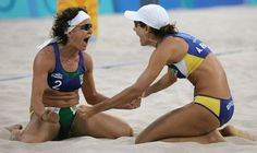 Inspirational Moments: Olympic celebrations - ATHENS - AUGUST 23: Shelda Bede #2 and Adriana Behar #1 for Brazil celebate after winning the women's semifinal match between Australia and Brazil on August 23, 2004 during the Athens 2004 Summer Olympic Games at the Olympic Beach Volleyball Centre at the Faliro Coastal Zone Complex in Athens, Greece. (Photo by Sean Garnsworthy/Getty Images)