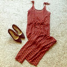 Burnt orange rust black chevron jumpsuit sheer NEW This burnt orange jumpsuit is comfortable yet seductive. Wear black high waist bottoms underneath and top with a large gold statement necklace for the perfect brunch look for meeting your friends!  The gold tone beads on the strap ties add just the right dose of shine. Condition: new H&M Dresses