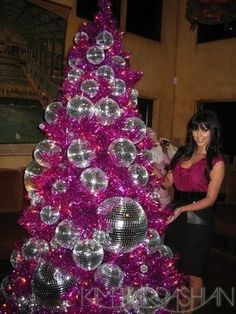 Love to see the different ways people decorate trees.  While I wouldn't do this at home, it looks awesome!