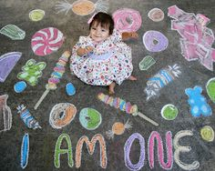 baby one year photo shoot with sidewalk chalk