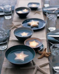 Use a set of graduated cookie cutters to make stars or other shapes in varying sizes. Arrange the candles on a platter, or place them in shallow dishes of water for a unique centerpiece.
