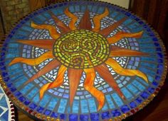 sun mosaic Think I'm going to do a mosaic kind of like this on an old table I have.