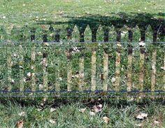 Gartengestaltung - Mirror picket fence reflects the landscape