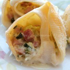 Lumaconi ripieni con zucchine prosciutto e besciamella cotti in forno.Pasta ripiena con zucchine gustosa,adatta ad ogni occasione e si prepara in poco tempo