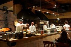 Restaurant guests are much more interested  in what goes on in the kitchen nowadays. Offering guests a Chef's Table to dine at in the kitchen or performing cooking demos for an audience would be a big seller in the Bistro.