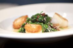 Seared scallops with sauteed baby spinach, apple wood smokedd bacon and shredded Parmesan