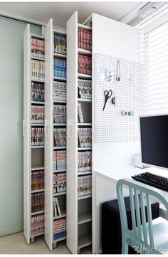 Actually, it is just bookshelves with heavy duty rollers on the bottom and some kind of Guide on top. You could probably adapt the guide from bifold closer doors to make this work.