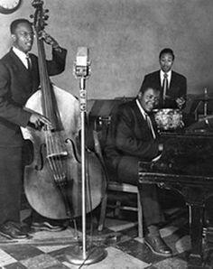 The original Oscar Peterson Trio: Austin Roberts (bass), Clarence Jones (drums), and Oscar Peterson (piano) at the Alberta Lounge.