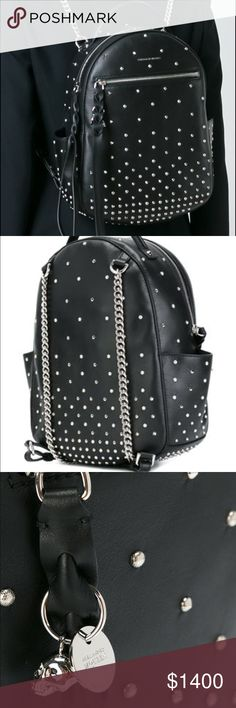 Alexander McQueen studded backpack Stud all over detail with smooth leather backpack featuring a front zippered pocket and two side open pockets. This has a top zip fastening, with long leather zip polls and interlocking detail with a polished skull charm with crystal eyes. Top handle an adjustable leather and chain shoulder straps, with inner zipped pocket. And of course 100% authentic Alexander McQueen Bags Backpacks