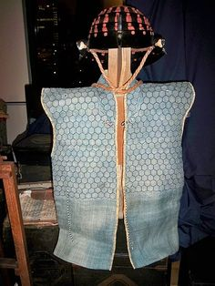 Antique Japanese (samurai) Edo period kikko manchira or a vest made with hexagon armor plates kikko. The kikko is sewn between 2 layers of cloth. The helmet is a chochin kabuto or collapsible helmet.