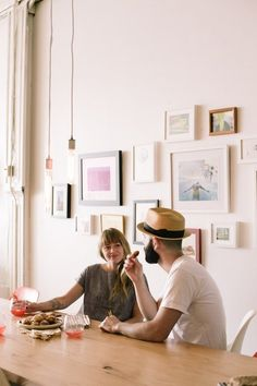 """a gallery wall to spark a little conversation? . . . . . .  10 Dinner Table Discussions Beyond """"How Was Your Day?"""" — The Kitchn"""