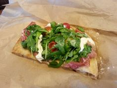 Eataly just opened in Westfield World Trade Center and we had to try their prosciutto & arugula pizza. Yum!