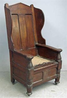 An 18th century joined oak Lambing Chair  auction estimate £1,200-1,400