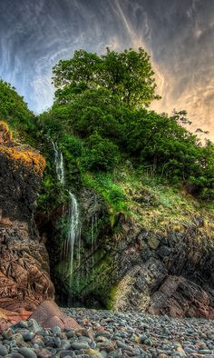 Beach Waterfall ,Waterfall on Clovelly beach in North Devon