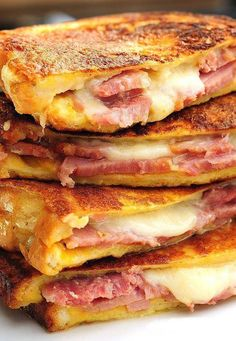Monte Cristo.Melted cheese with crisp roasted bread is the tastiest combo that's going to make anyone go completely crazy! Assemble with honey, jam, mayo or mustard it's going to be enjoyed by anyone.