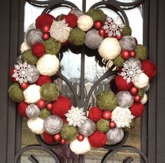 Christmas yarn ball wreath with snowflakes and ornaments that I made for our front door. Love it!
