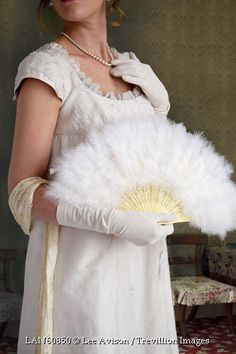 Trevillion Images - historical-regency-woman-holding-feathered-fan