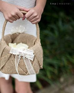 Burlap and bow flower girl basket.