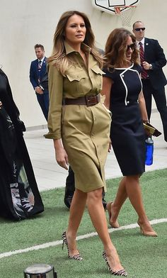 A khaki military shirt dress and zebra print stilettos were the choice for the First Lady's tour of the American International School in the Saudi capital Riyadh on May Photo: GIUSEPPE CACACE/AFP/Getty Images Source by citrusfreshen Dresses Mode Outfits, Fashion Outfits, Womens Fashion, Fashion Trends, Fashion Pants, Hijab Fashion, Melanie Trump, Moda Safari, Milania Trump Style