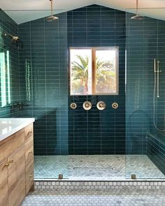 Who else needs a weekend retreat in this breathtaking master bath? 🙌🏽 used our Tempesta Polished Marble Floor Tile paired with the glossy blue-green tones of our Color Mind Ceramic Wall Tile to achieve this glam bathroom oasis! Color Mind, Blue Green Bathrooms, Bathroom Trends, Bathroom Ideas, Bathroom Inspo, Basement Bathroom, Bathroom Remodeling, The Tile Shop, Shops