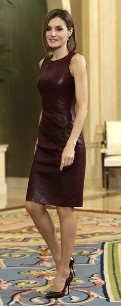 Queen Letizia of Spain goes for leather in a Hugo Boss burgundy dress with matching high heels, to meet with organizers of 10th Yo Dona International Awards during an audience at La Zarzuela Palace, in Madrid