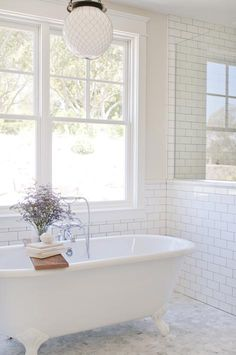 Gah! Clawfoot tub dreaminess. Love the subway tile with grey grout too.  Bixby & Ball