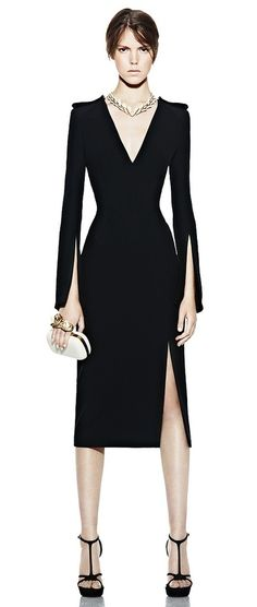 Black knee-length dress with arm and leg slits. Alexander McQueen.