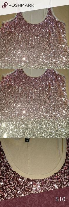 Pink and gold sparkle sequin tank Pink and gold sequin sparkle top. Pink fading into gold. Tan fabric for the back. Bust 34/36 length 26. Rounded bottom. Express Tops Tank Tops
