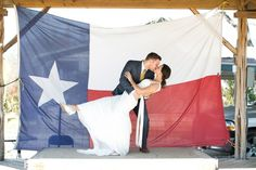 A Picture In Front Of The State Flag: If you can grab a state flag or another fun flag like your college flag you might be able to capture a fun picture like this couple did.