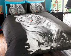 Tiger Duvet Set -  This stunning white tiger photographic print duvet cover and pillow covers will make your bedroom both unique and extraordinary.  Available in 3 sizes of duvet sets (single with 1 pillowcase, double and king size with 2 pillowcases).