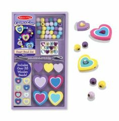 Melissa & Doug Heart Bead Set by Melissa & Doug. $5.96. Presented in a wooden tray. Stick-on jewels, stickers, 3 color-coordinated cords and over 35 wooden heart-shaped beads included. Design a variety of necklaces with a heart theme. Ages 4 years and above. Ideal party favor or activity. From the Manufacturer                Fulfill your heart's desire for lovely jewelry by creating beautiful necklaces with this charming hand-crafted bead set. Use the heart ge...