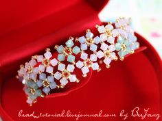 """Tutorial : Crystal Bracelet #20 Level : Intermediate Technique : Cross-weaving The design is from the book """"Rocca #4 """". This is similar to this bracelet . I think it is lovely so I make one and prepare a tutorial for you here. Equipment : - Swarovski Bicone Crystal 4 mm. - Seed Bead…"""