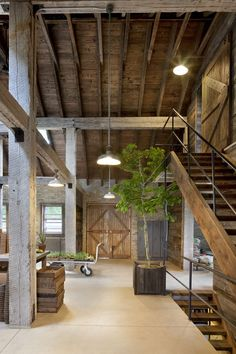 Very rustic approach with exposed wood beams and columns. The space is open yet feels comfortable with the use of natural materials.