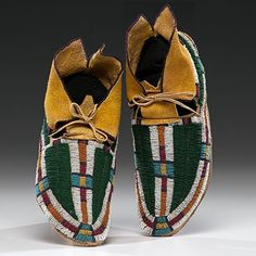 Lot:Arapaho Beaded Hide Matched Leggings and Moccasins , Lot Number:250, Starting Bid:$2500, Auctioneer:Cowan's Auctions, Inc., Auction:American Indian Art, Date:07:00 AM PT - Apr 5th, 2013
